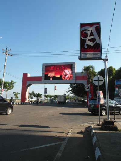 A new over-road digital screen feeds drivers cigarette ads in Makassar, Sulawesi, Indonesia