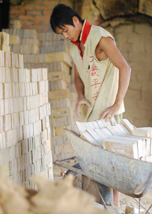 A Chinese-Indonesian worker in a brick factory in Kalimantan