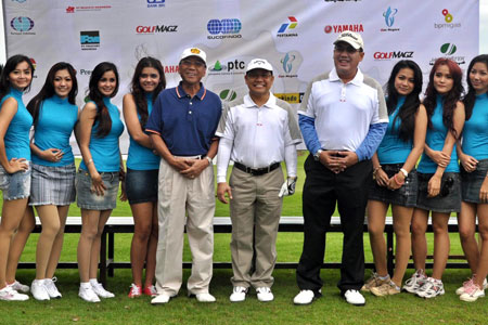 Indonesian ministers pose with mini-skirted golf caddies