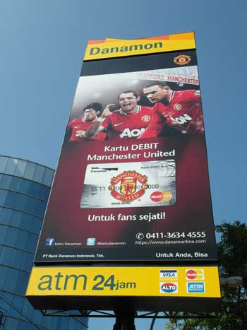 An advertisment for Manchester United branded debit cards, for True Fans in Indonesia